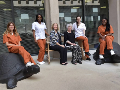 Mary Walker (Center), Dean Stuifbergen and AE-MSN students Marissa Wasmuth, Isabelle Yapobi, Kate Palladino and Anastasia Adams.