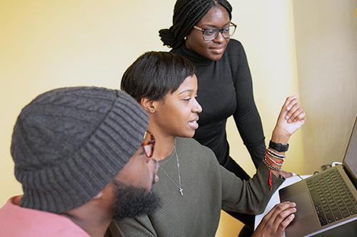 African American people working together in the computer