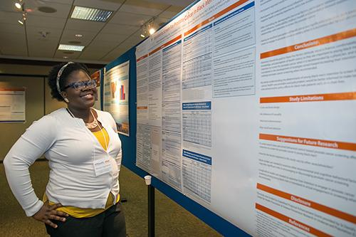 Student infront of her research poster