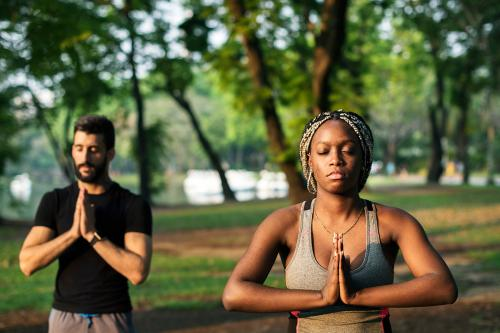 People doing yoga in a park
