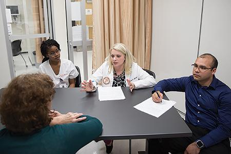 Students from Nursing, Pharmacy, Medicine and Social Work collaborate on a patient case.