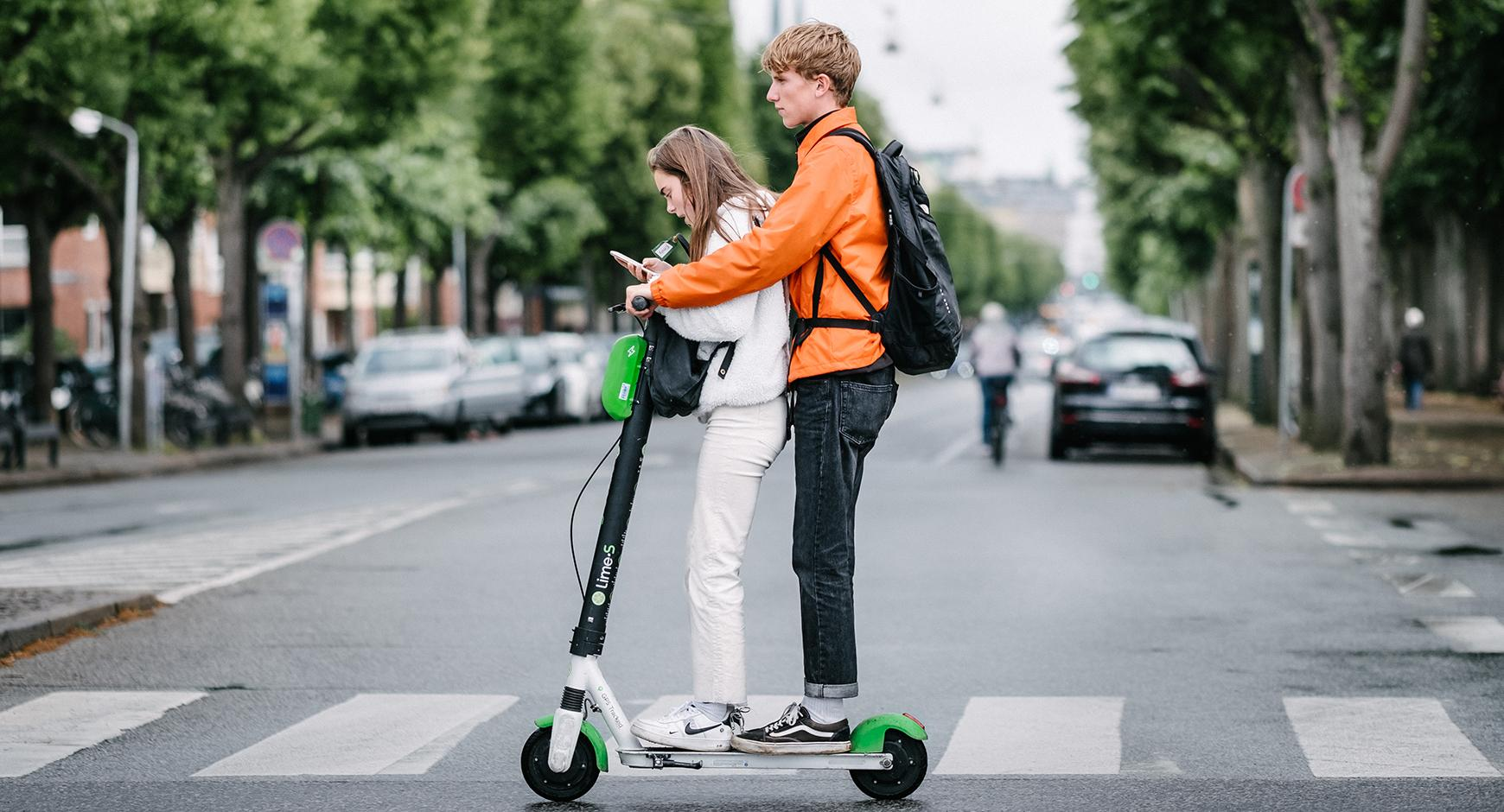 People riding on Electric Scooter. Photo Credit to Kristoffer Trolle from Copenhagen, Denmark, CC BY