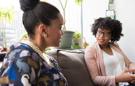 African American Women talking with each other