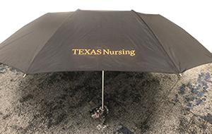 School of Nursing branded umbrella